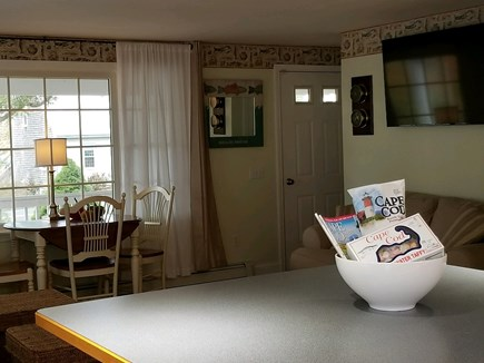 Dennisport Cape Cod vacation rental - Dining/living area includes Vermont Castings gas fireplace