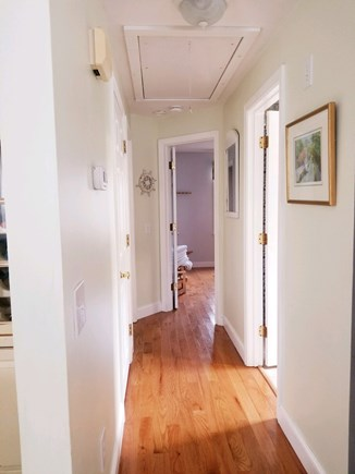 Dennisport Cape Cod vacation rental - Hallway with gleaming floors and original CC Kennedy Artwork