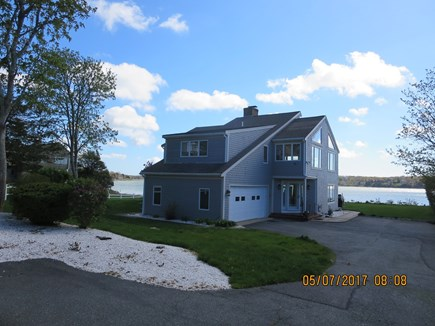 Orleans and Eastham Border Cape Cod vacation rental - Front of house with Cove in Background