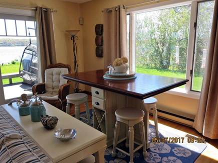 Orleans and Eastham Border Cape Cod vacation rental - Bar table/seats in back of living room