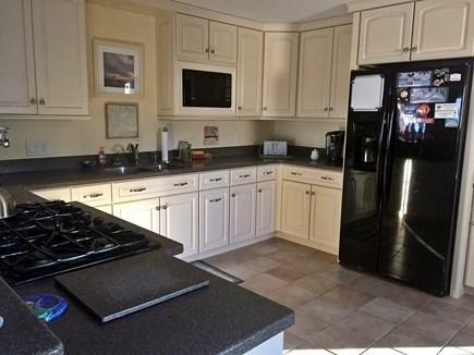Orleans Cape Cod vacation rental - Half of Kitchen. 5 Burner Gas Stove.  Microwave. Refrigerator.