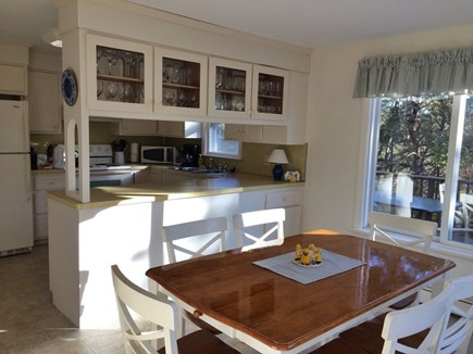 Chatham Cape Cod vacation rental - Bright, eat in Kitchen.View of private large deck & conservation