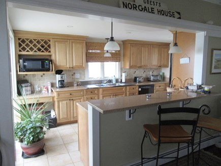 Dennis Cape Cod vacation rental - Kitchen open to dining has slider to patio