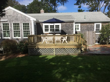 Orleans Cape Cod vacation rental - Back deck and sunroom overlook the yard with a h/c outdoor shower