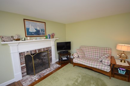 Orleans Cape Cod vacation rental - Living room with fireplace and couches