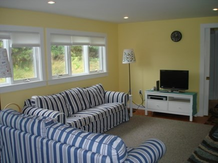 Wellfleet Cape Cod vacation rental - Living room open to dining, kitchen, deck & screened in porch.