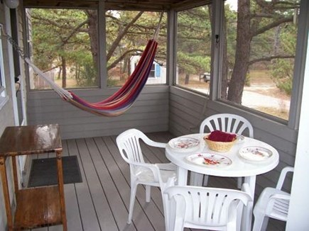 Wellfleet Cape Cod vacation rental - Screened in porch off main level, living area.