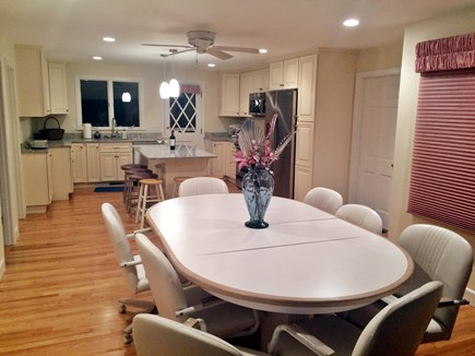 Falmouth Cape Cod vacation rental - View of kitchen from sun room with seating for 8