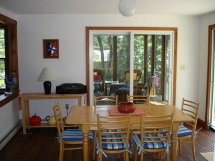 Wellfleet Cape Cod vacation rental - Dining room open to living room, screened porch & back yard views