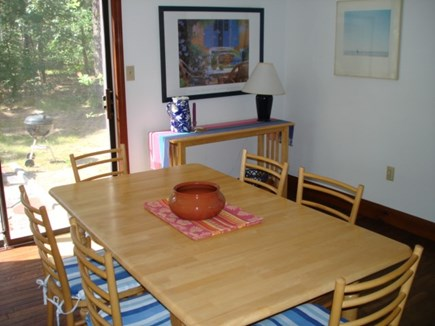 Wellfleet Cape Cod vacation rental - Dining with sliders to back yard patio.