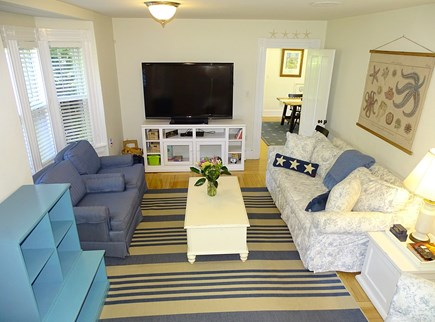 Orleans Cape Cod vacation rental - Open airy living room, stairway to upstairs, door to front yard