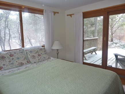 Truro Cape Cod vacation rental - Third bedroom looking out to small deck on a snowy day