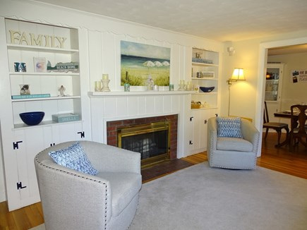 West Harwich Cape Cod vacation rental - Living room with built in cabinets, fireplace