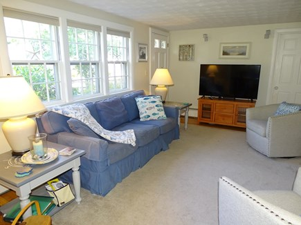 West Harwich Cape Cod vacation rental - View of living room, showing couch and television