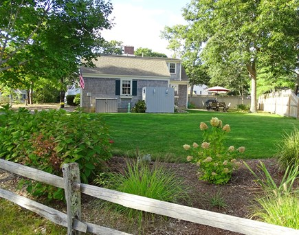 West Harwich Cape Cod vacation rental - Spacious back yard, showing gardens and outdoor shower