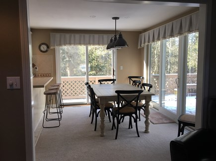 New Seabury, Mashpee New Seabury vacation rental - Dining area seats 6 at table, 3 at peninsula. 2 sliders to deck.