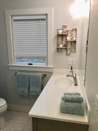 Chatham Cape Cod vacation rental - The bathroom is set at the back of the house, all white!