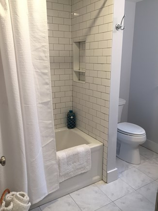 Chatham Cape Cod vacation rental - Fully renovated bath and shower with trendy subway tiles.