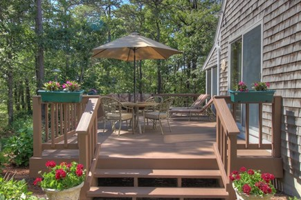 Wellfleet Cape Cod vacation rental - Enjoy meals on the deck overlooking a beautiful, secluded yard
