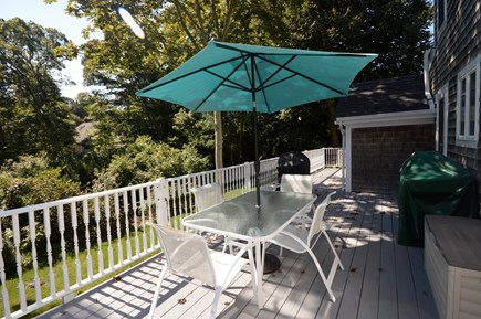 Orleans Cape Cod vacation rental - Long deck with stairs to bottom floor, gas grill & outdoor dining
