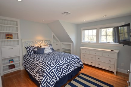 Orleans Cape Cod vacation rental - Upstairs Queen Bedroom with flat screen Smart TV and bunk beds
