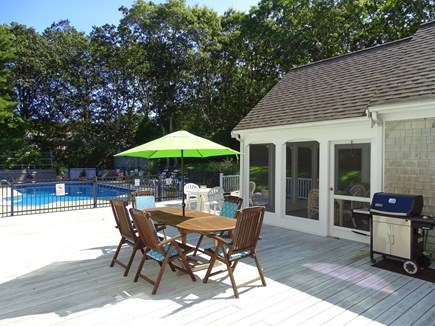 Barnstable Village Cape Cod vacation rental - Large deck area with grill and table for dining, leads to porch