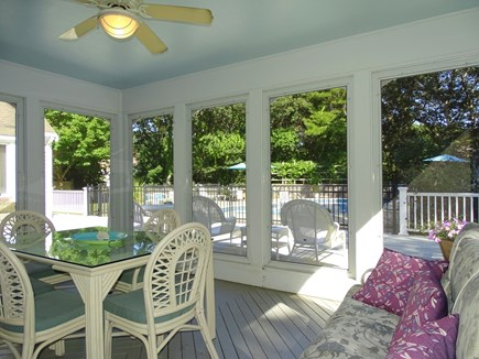 Barnstable Village Cape Cod vacation rental - Best seat in the house – porch overlooking pool area