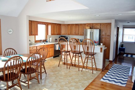 Sandwich, Town Neck Cape Cod vacation rental - Kitchen/dining with sliders to beach side deck