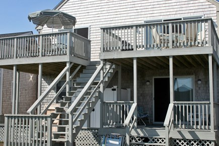 Sandwich, Town Neck Cape Cod vacation rental - 1st floor deck; 2nd floor decks off living/dining; outdoor shower