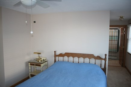 Sandwich, Town Neck Cape Cod vacation rental - 1st floor queen bedroom with sliders to beach side deck