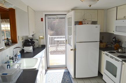 East Dennis Cape Cod vacation rental - Kitchen out to back deck