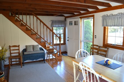 East Dennis Cape Cod vacation rental - Dining room and stairs to upstairs bedroom with 3 twins