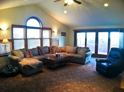 Brewster Cape Cod vacation rental - Second floor family room with sliders to the deck.