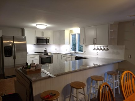Eastham Cape Cod vacation rental - Kitchen dining for 13: 8 at the table & 5 at the counter