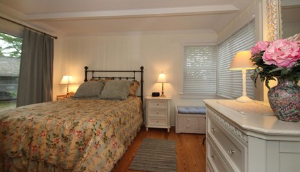 Hyannis Port Cape Cod vacation rental - Master Bedroom has a queen size bed, sliders onto brick patio.