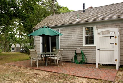 Hyannis Port Cape Cod vacation rental - brick patio w/outdoor shower. Enjoy your morning coffee here.