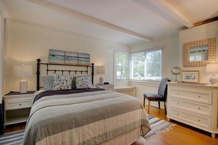 Hyannisport Cape Cod vacation rental - Master Bedroom has a queen size bed, sliders onto brick patio.