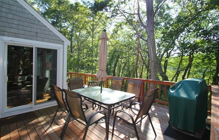 Hyannisport Cape Cod vacation rental - The deck has a Weber Grill, chaise lounges, table ,chairs for 6