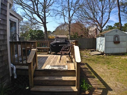 Yarmouth Cape Cod vacation rental - Side view of yard and deck.