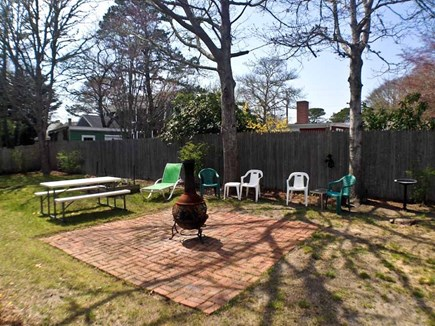 Yarmouth Cape Cod vacation rental - The yard has outdoor furniture.
