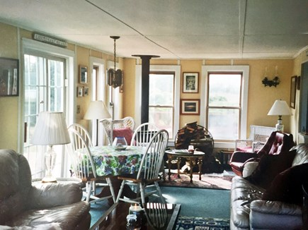 Wellfleet Cape Cod vacation rental - Family Room w/Wood Burning Stove and 2 sliding doors to decks.