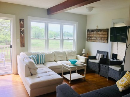 Onset MA vacation rental - Living room with slider to deck. Leather couch.