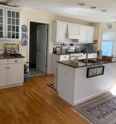 New Seabury Cape Cod vacation rental - KItchen and doorway leading to first floor laundry and garage