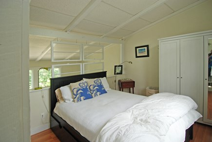 Provincetown Cape Cod vacation rental - Queen-sized bed and armoire.