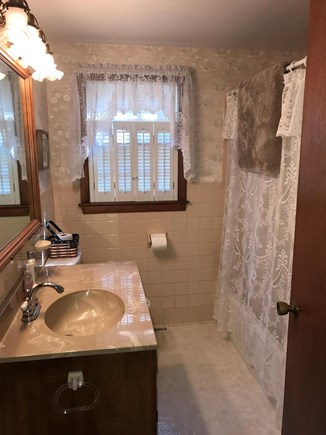 West Yarmouth Cape Cod vacation rental - Main bathroom with tub and shower.