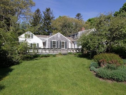 Harwich Cape Cod vacation rental - The side yard with its lush lawn is fully fenced.