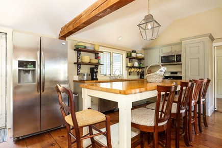 Harwich Cape Cod vacation rental - The well equipped kitchen features a big island table