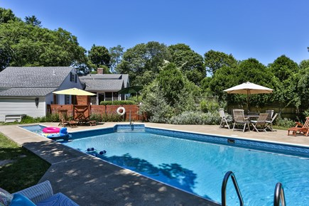 Harwich Cape Cod vacation rental - Large in ground swimming pool with the house in the background