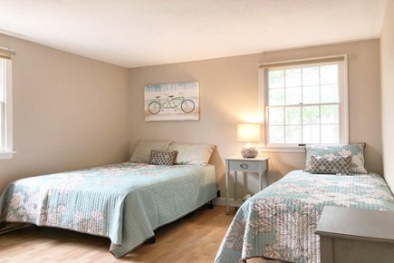 East Sandwich Cape Cod vacation rental - First floor bedroom with queen and twin beds