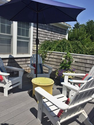 Harwich Port Cape Cod vacation rental - 4 Adirondack seating area off kitchen area